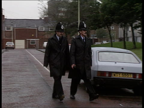 Tyne and Wear Hebburn TGV River Tyne with council estate PULL OUT MS Two policemen toward PAN LR Bill Mutch intvwd SOF Arson and attacks were rife/...