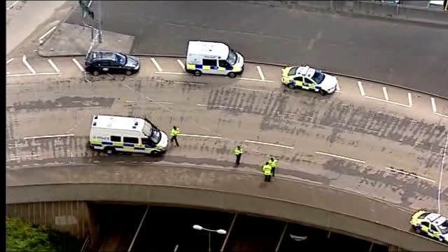 stockvideo's en b-roll-footage met day six of manhunt for raoul moat / two men appear in court lib tyne and wear newcastleupontyne east denton aerials roundabout at motorway junction... - tyne and wear