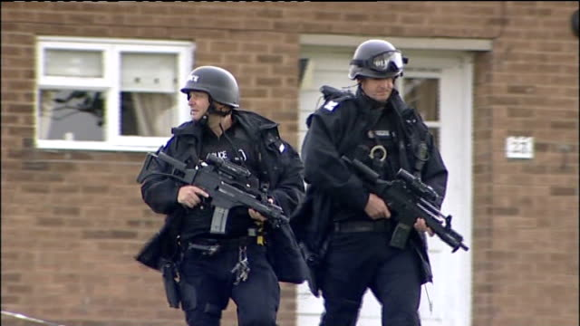 police manhunt for gunman after triple shooting ENGLAND Tyne and Wear Gateshead EXT General view of armed police officers along including close shot...