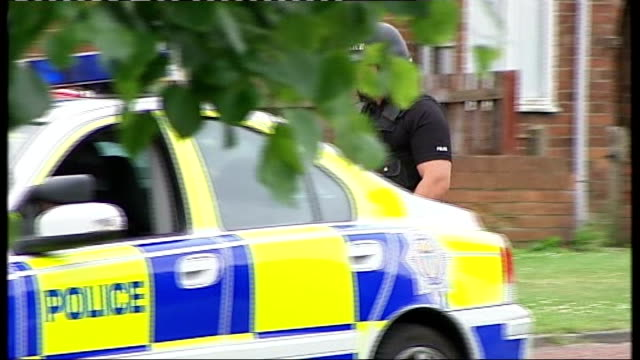 stockvideo's en b-roll-footage met suspect raoul moat still on the run tyne and wear stanley armed police officer along in residential area officer cordoning off road with tape armed... - tyne and wear