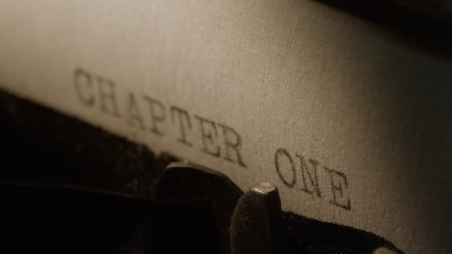 LD Type bars of old typewriter printing out CHAPTER ONE
