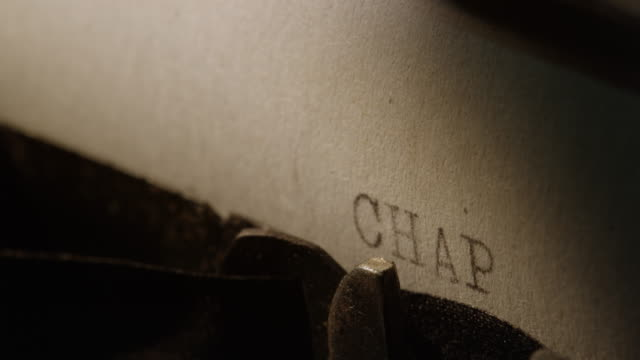 LD Type bars of old typewriter printing out CHAPTER TWO