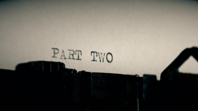 type bars of old typewriter printing out word part two - macchina da scrivere video stock e b–roll