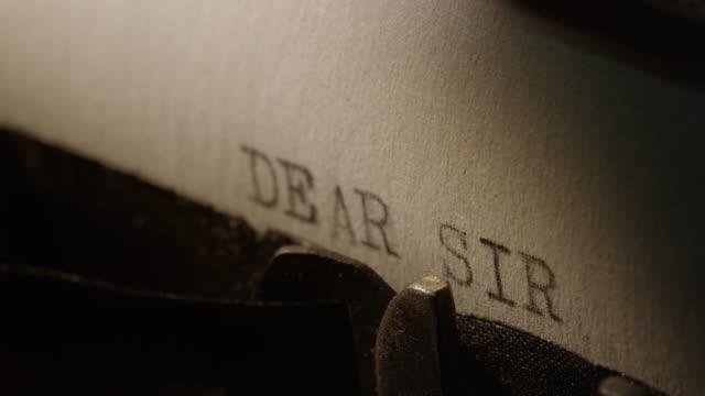 LD Type bars of old typewriter printing words DEAR SIR