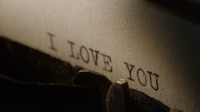 type bars of old typewriter printing words i love you - love stock videos & royalty-free footage
