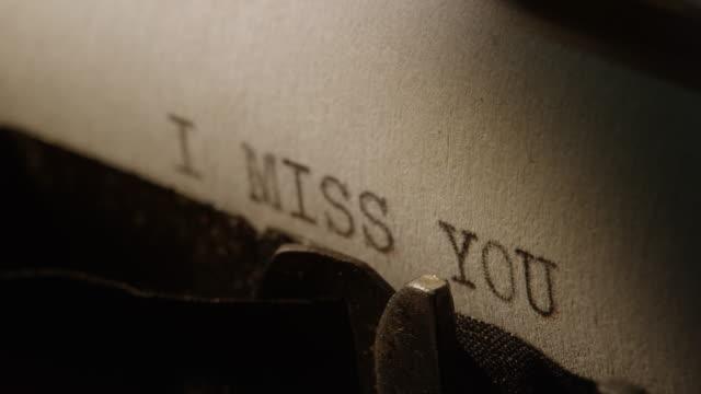 type bars of old typewriter printing words i miss you - typewriter keyboard stock videos & royalty-free footage