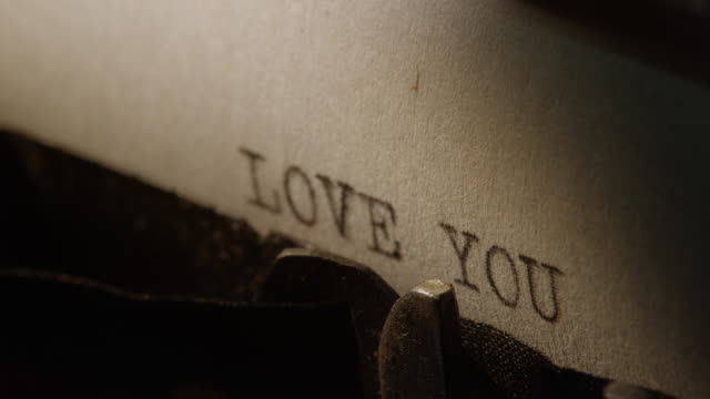 ld type bars of old typewriter printing words love you - i love you stock videos and b-roll footage