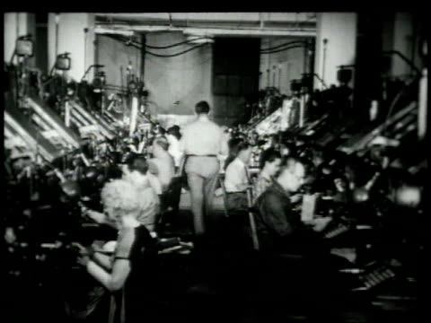 1948 montage typesetters working in a printing press / new york city, new york, united states - 1948 stock-videos und b-roll-filmmaterial