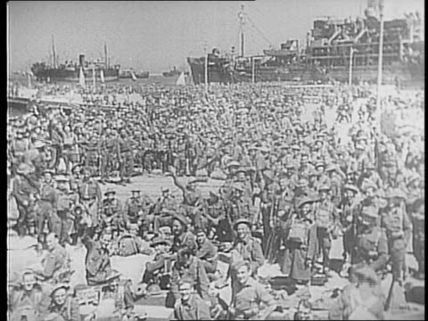 vidéos et rushes de typewriter message / docks at alexandria egypt jammed with soldiers in uniform, ships / soldiers walk down stairs to dock / soldiers on pier with... - alexandrie