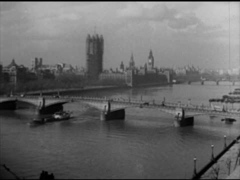 typewriter typing xws river thames w/ westminster bridge westminster palace bg int vs 'march of time' headquarters office assistants delivering note... - britisches parlament stock-videos und b-roll-filmmaterial