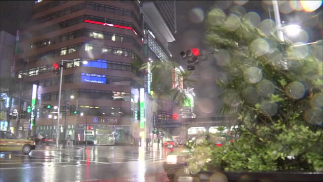 Typhoon generated rainstorm blows over Shibuya crossing / Typhoon No19 Vongfong hit Kagoshima on October 13 2014 and swept through the Japanese...