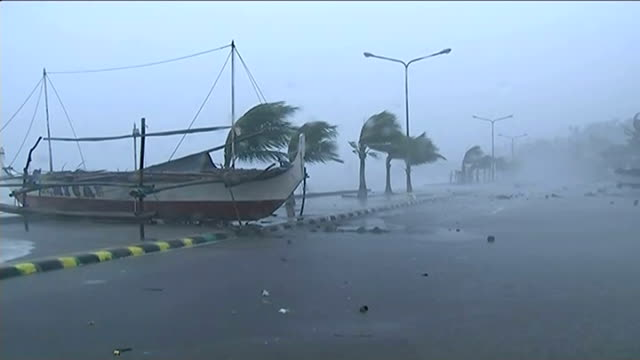 typhoon hagupit sweeps across the philippines 'cmd' sign on building in quiet street as motorbike towards low angle view man along quiet street with... - bending stock videos & royalty-free footage