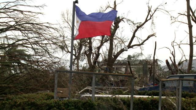 typhoon haiyan aftermath philippines flag flies amid destruction - philippines flag stock videos & royalty-free footage