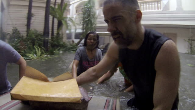 stockvideo's en b-roll-footage met typhoon haiyan dramatic rescue in storm surge flood - slachtoffer