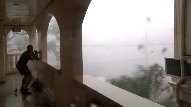 typhoon haiyan hurricane winds hit tacloban city - hurricane stock videos and b-roll footage
