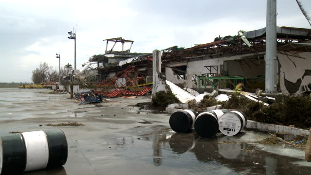 typhoon haiyan military helicopter at devastated tacloban airport - stahlfass stock-videos und b-roll-filmmaterial