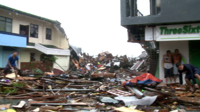typhoon haiyan storm surge destruction and survivors in tacloban city - cyclone stock videos & royalty-free footage