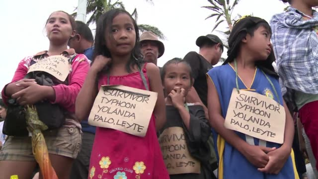 Typhoon Haiyan survivors including children evacuate from Tacloban airport Leyte province as rescue workers struggle to care for the sick and injured...