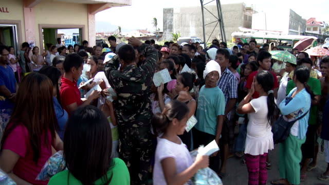 typhoon haiyan survivors receiving aid in tacloban - victim stock videos & royalty-free footage