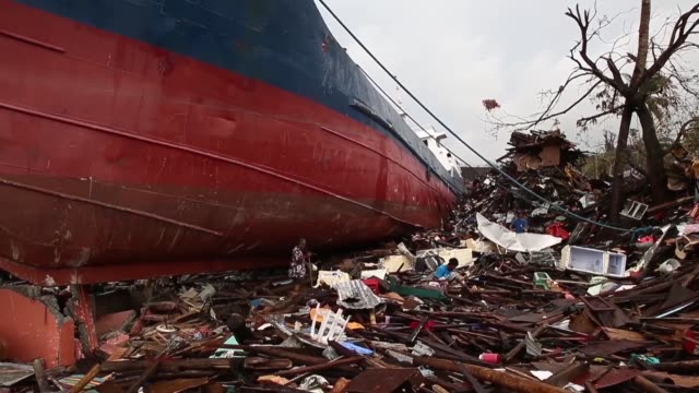 typhoon haiyan, which ripped through philippines on november 9, has been described as one of the most powerful typhoons ever to hit land, leaving... - land feature stock videos & royalty-free footage