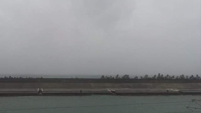Typhoon Matmo churns towards Taiwan picking up strength with thousands of tourists evacuated from outlying islands as weather forecasters warn of...