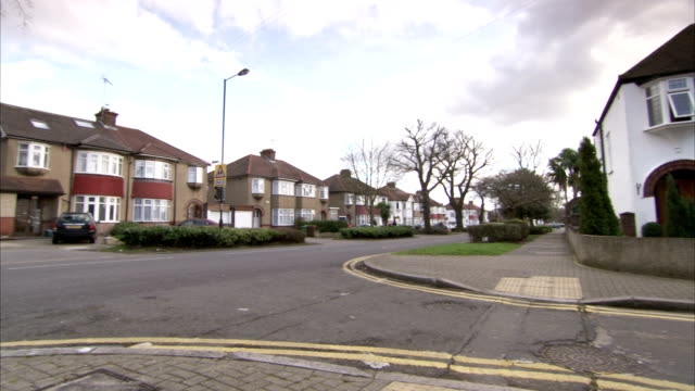 Typical 1930s houses line The Greenway in the Rayners Lane district of London. Available in HD.
