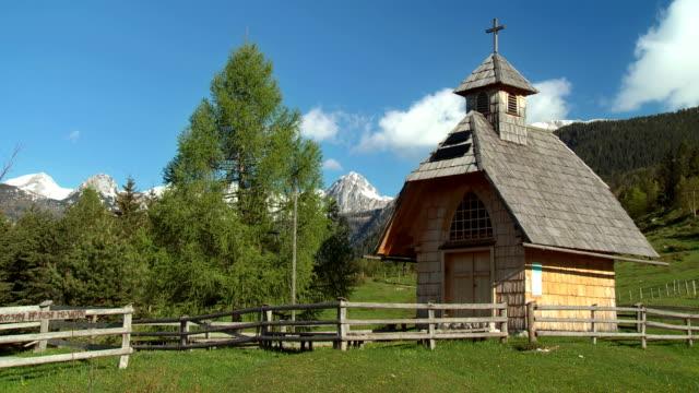 WS Typical Alpine Slovenia old Christian church, icon of Uskovnica village / Bohinj, Triglav National Park, Slovenia