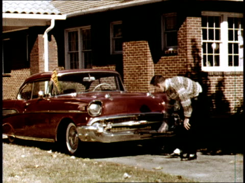 / typical american teenage boy walks out to his 1957 chevrolet bel air twodoor hard top and admires it / teen opens the hood and checks it out gets... - chevrolet stock videos & royalty-free footage