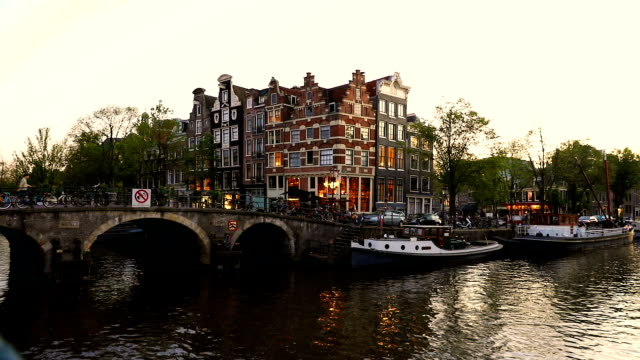 typical bridge on the canals in the central amsterdam - dutch culture stock videos and b-roll footage
