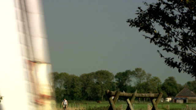 typical dutch windmill in a polder, the netherlands - polder stock videos and b-roll footage