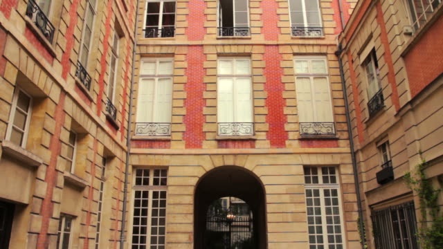 typical house and urban scene in paris, france - courtyard stock videos & royalty-free footage