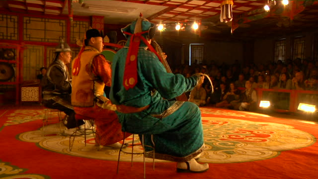 ms typical mongolian stage performance with playing instruments audio / ulaan baatar, mongolia - モンゴル点の映像素材/bロール