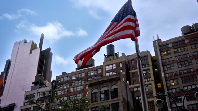 Typical New York building and American flag