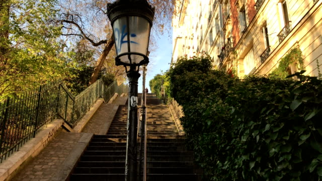 typical parisian stairs in montmartre in paris france - basilique du sacre coeur montmartre stock videos & royalty-free footage