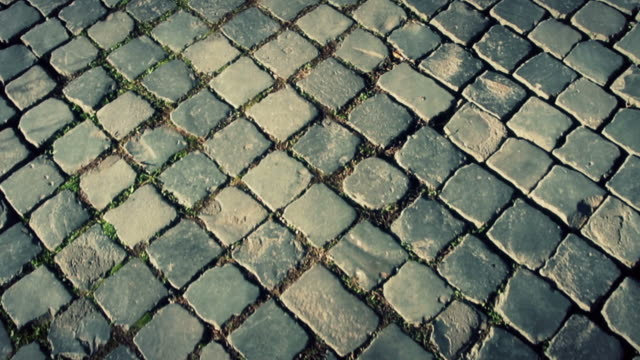 typical sanpietrino roman road panning video - stone material stock videos & royalty-free footage