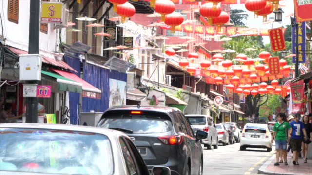 a typical street with red lanterns in chinatown, malacca, malaysia - malacca stock videos and b-roll footage