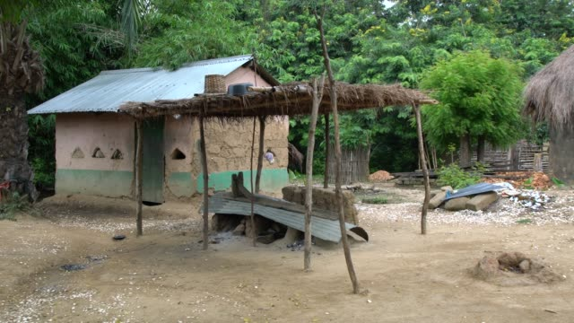 typical termite clay african house in a small village on volta river, ghana - tradition stock videos & royalty-free footage
