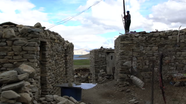 typical tibetan stone houses in the village of karzok (korzok) in ladakh, india - stone house stock videos & royalty-free footage