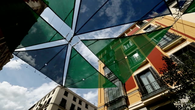 typical toldo sunshade on spanish buildings - awning stock videos and b-roll footage