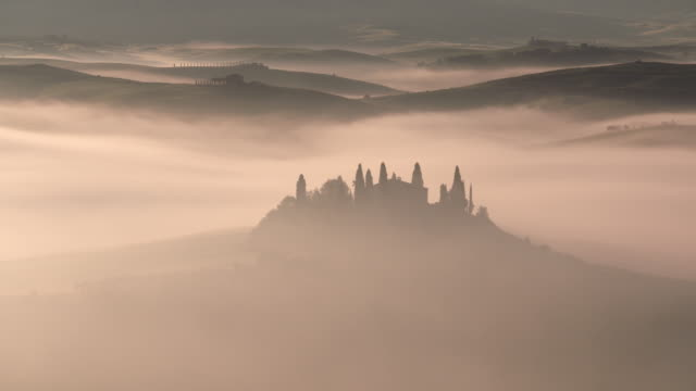 Typical Tuscany landscape with farmhouse at morning with fog. UNESCO World Heritage Site. San Quirico d'Orcia, Val d'Orcia, Tuscany, Siena Province, Italy, Europe.