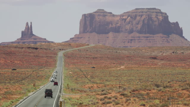 typical view of the monument valley and highway 163 - monument valley stock videos & royalty-free footage