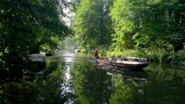 Typical water channel with barge excursion boat in the Spreewald, Lübbenau, Spreewald, Brandenburg, Germany