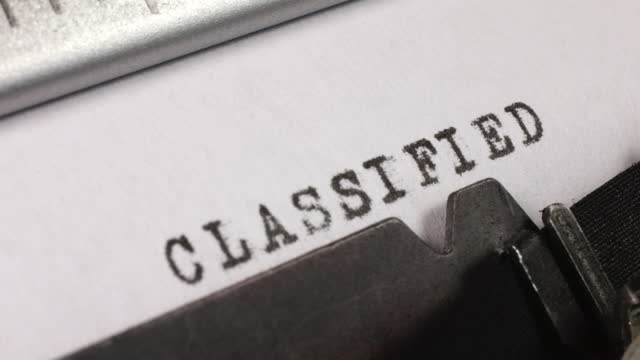typing classified on an old manual typewriter. - the alphabet stock videos & royalty-free footage