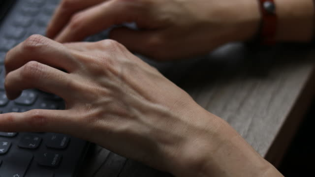 Typing fingers push computer