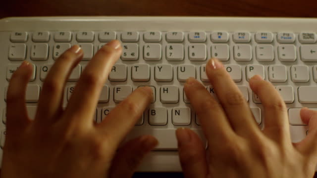 CU Typing on a computer keyboard