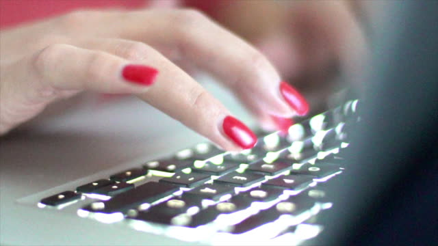 typing on a laptop keyboard. - red nail polish stock videos and b-roll footage