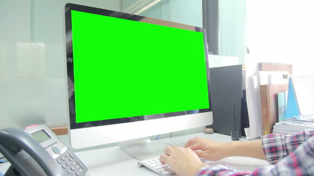 Typing on computer with green screen