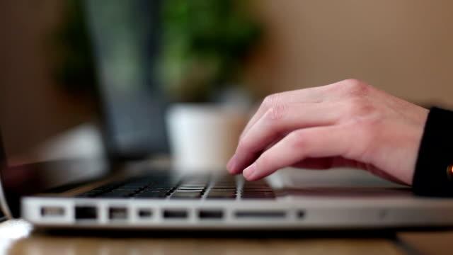 Typing On Laptop Keyboard in Coffee shop