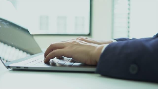 typing on laptop keyboard - enter key stock videos & royalty-free footage