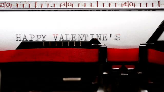 typing short phrase 'happy valentines day' with an old typewriter - short phrase stock videos and b-roll footage